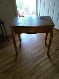 rectangular brown wooden table with drawer