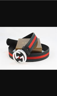 black, green, and red Gucci leather belt with stainless steel buckle