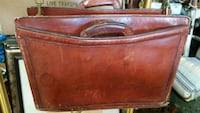 Leather attached case with hand or arm strap