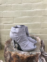 pair of gray suede open-toe platform high-heeled side-zip booties
