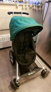 baby's green and black jogging stroller