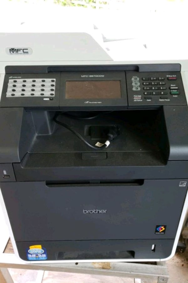 black and white Brother multi-function printer f07d88bd-a6a6-4550-ba6f-33dc75216059