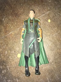 male fictional character wearing green suit with cape action figure