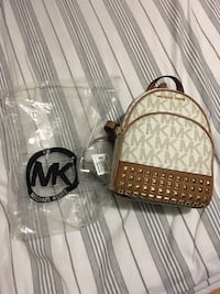 brown and white leather Michael Kors backpack