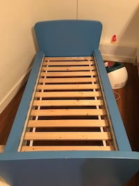 blue and white wooden bed frame