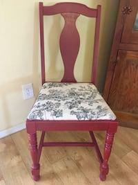 brown wooden chair with floral cushion