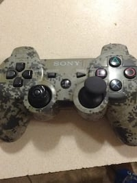 gray and black Sony PS3 controller Calgary, T2A 7K4