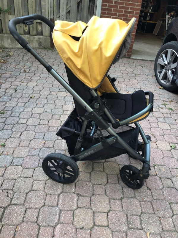 Uppababy Vista stroller, 2011. Black metal with yellow accents. 0248d537-8146-4ad6-b183-6fe56d65c06c