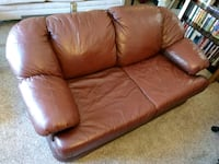 Red faux leather loveseat 1156 mi