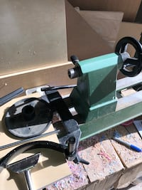 Green and black metal lathe
