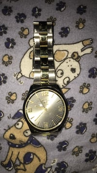 Round gold analog watch
