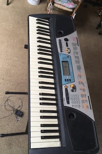 Electric piano with adjustable stand