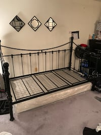 Black metal bed frame with pull out frame for another mattress Germantown, 20874