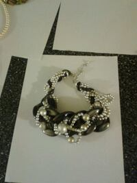 silver-colored and black bracelet