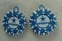 two white-and-blue cowboy earrings