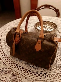 borsa in pelle marrone Louis Vuitton Monogram Roma, 00172