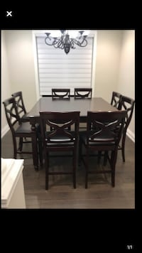 Dining table. 8 chairs and pub style table. Good condition. Pet and smoke free  Vaughan, L4H 2G2