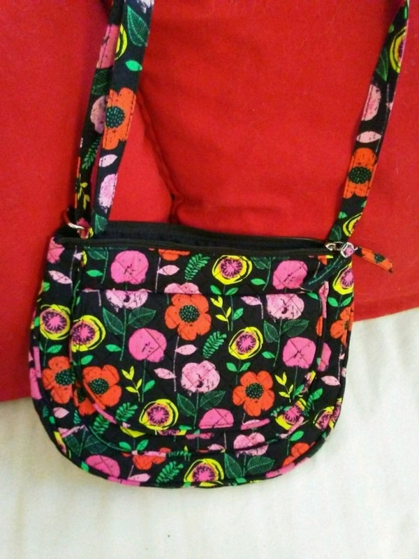 black, green, and pink floral crossbody bag