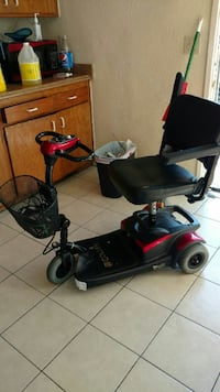 black and red mobility scooter