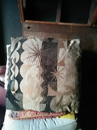 brown and beige floral throw pillow