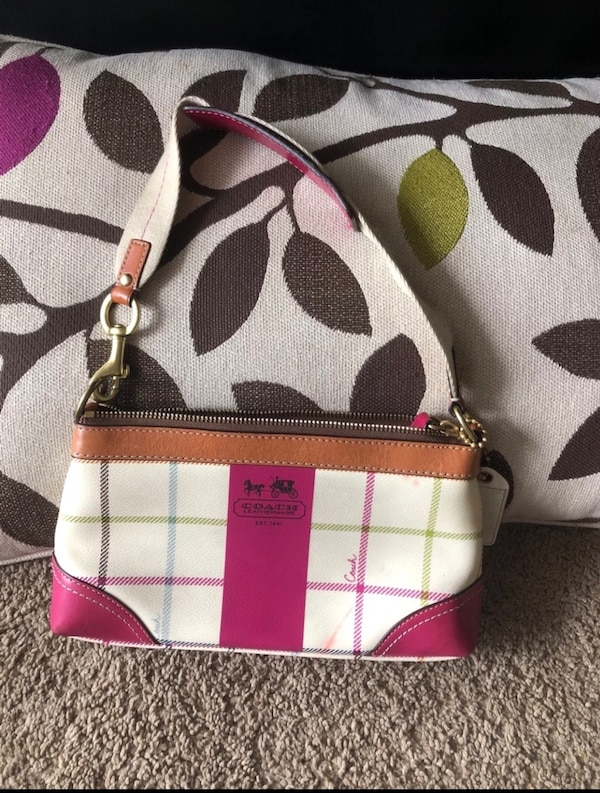 White, pink, and black coach leather shoulder bag