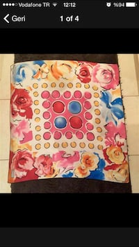 White pink blue red and orange floral textile