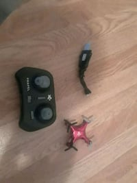 black and red quadcopter with remote Erie, 16503
