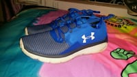 pair of blue Under Armour running shoes Mercedes