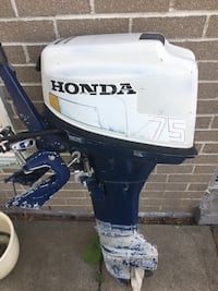 black and white Evinrude outboard motor Toronto, M4V 1P7