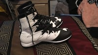 Pair of white-and-black under armour football cleates