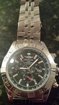 round silver Rolex chronograph watch with link bracelet