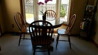 brown wooden pedestal table with four windsor chair dining set Niagara Falls, L2G 7R9