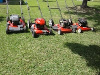 red and black push mowers 874 mi