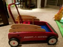 Toddler's red and brown radio flyer wagon