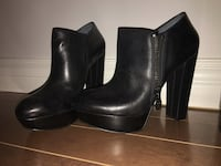 women's pair of black leather platform chunky heeled booties Sorel-Tracy, J3P