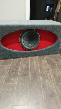 red and gray subwoofer with enclosure