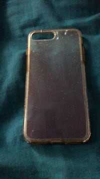 black Android smartphone with brown case 617 mi