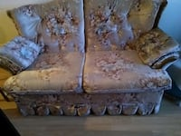 gray leather floral love seat