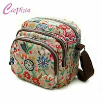 beige, green, and blue floral Ciephia backpack