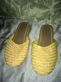 Pair of yellow shoes/slippers Calgary, T2A 6E4