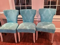 Three teal upholstered chairs ($80 each) Arlington
