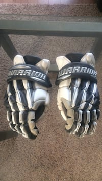 Pair of black-and-white lacrosse gloves Calgary, T2Y 3P9