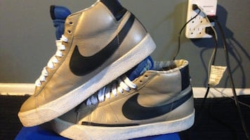 Pair of brown black and white nike high top sneakers