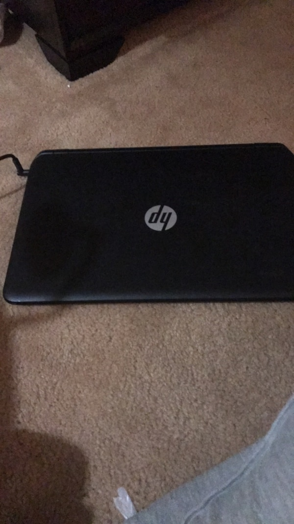 Black hp laptop with ac adapter
