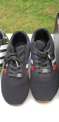 Pair of black-and-white adidas running shoes Riverview Park, 19605