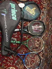 Set of four tennis racquets with covers