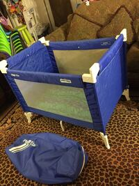 blue and white Play 'N Go travel cot