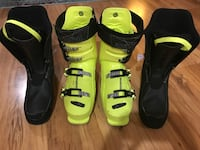 Pair of black and yellow ski boots Central Okanagan