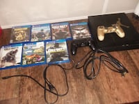 black Sony PS4 console with controllers and games Houston, 77009