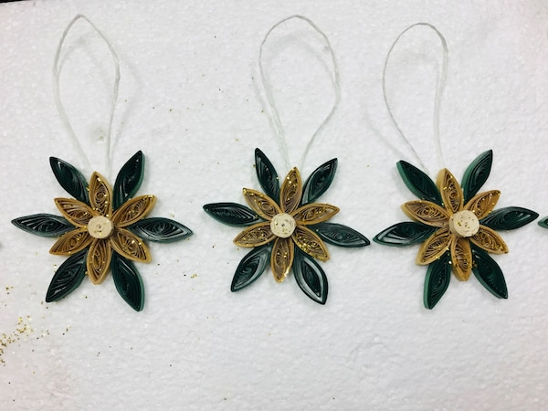 three green-and-brown flower ornaments